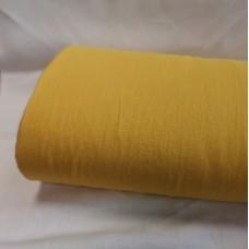 Mīkstināts vienkrāsains lina audums koši dzeltenā krāsā